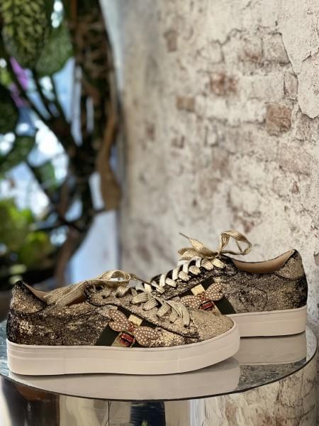 Damen goldene Sneaker mit Streifen und Bienen Applikation